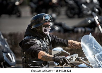 Brutal biker with skeleton mask. unidentified motorcycle rider in a mask takes part in a motorcycle parade