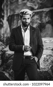 Brutal businessman with beard and gray. Stylish business man in jacket costume. Nordic Karelian nature landscape background. Marble Canyon and Dramatic sky in Karelia republic. Karelian forest.