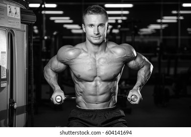 Brutal caucasian handsome fitness men on diet training chest pumping up body