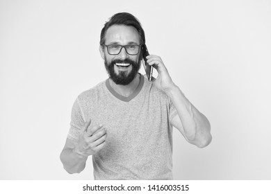 brutal caucasian hipster with moustache. happy conversation. Business. Bearded man speaking on phone. modern life with digital technology. Mature hipster with beard. Confident and handsome Brutal man.