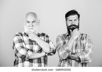 brutal and confident. youth vs old age compare. retirement. two bearded men senior and mature. barbershop and hairdresser salon. father and son family. male beard care. checkered fashion.