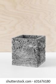 Brutal grey pot of concrete for indoor houseplants