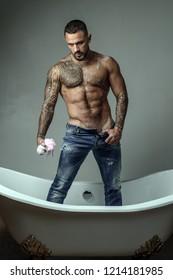 Brutal handsome man with tattooed body. Men fashion Brutal models