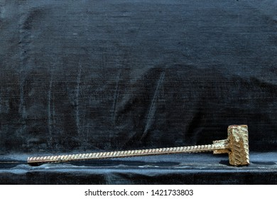 brutal iron sledgehammer of thick reinforcement on a black background