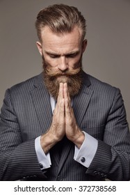 brutal man with beard in classic suit in modern style portrait