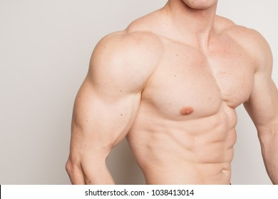 brutal man bodybuilder shows inflated muscles and an athletic figure. body part: washboard abs and broad shoulders. anatomical features of the male body