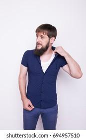 brutal man with long, bushy beard on a clean face. posing in a photo Studio. emotional portrait. Wallpaper for desktop