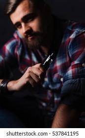 Brutal man smoking electronic cigarette