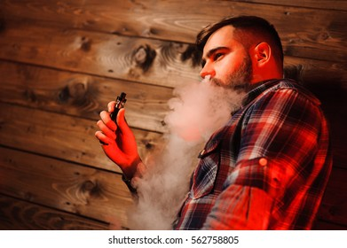 Brutal man smoking electronic cigarette