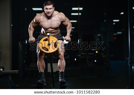81f24443cbe Brutal sexy strong bodybuilder athletic fitness man pumping up abs muscles  workout bodybuilding concept background -