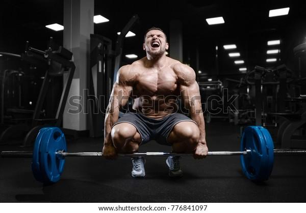 Sweaty Muscular Body Of Sporty Woman, Close Up Stock Photo