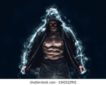 Brutal strong athletic bodybuilder posing. Electric power explosion from muscles after workout. Bodybuilding and healty life concept. Copy space for sport nutrition ads