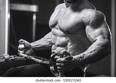 Brutal strong athletic men pumping up muscles workout bodybuilding concept background - muscular bodybuilder handsome men doing exercises in gym naked torso