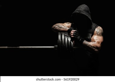 Brutal strong athletic men pumping up muscles workout bodybuilding concept background - muscular bodybuilder handsome men doing exercises in gym
