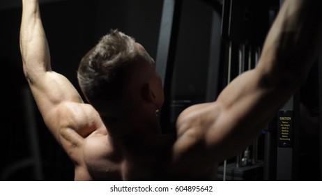 Brutal strong athletic men pumping up muscles workout bodybuilding concept background - muscular bodybuilder handsome men doing exercises in gym naked torso fitness and bodybuilding