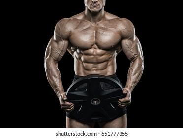 Brutal strong athletic men pumping up muscles workout bodybuilding concept background - muscular bodybuilder handsome men doing exercises