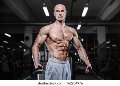Brutal strong bodybuilder athletic fitness man pumping up muscles workout bodybuilding concept background - muscular bodybuilder handsome men doing fitness exercises in gym naked torso