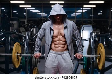 Brutal strong bodybuilder athletic fitness man pumping up muscles workout bodybuilding concept background - muscular bodybuilder handsome men doing fitness exercises in gym naked torso