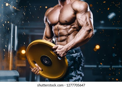 Brutal strong bodybuilder athletic man pumping up muscles workout bodybuilding concept background - muscular bodybuilder handsome men doing exercises in gym naked torso sport nutrition concept