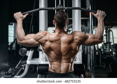 Brutal strong bodybuilder athletic man pumping up muscles workout bodybuilding concept background muscular bodybuilder handsome men doing exercises in gym naked torso