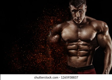 Brutal strong muscular bodybuilder athlete man pumping up muscles on black background. Workout bodybuilding concept. Copy space for sport nutrition ads.
