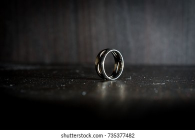 Brutal vintage male ring of expensive metal in dark colors with beautiful light