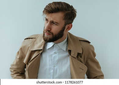 Brutal Young handsome bearded man portrait,well dressed looking away
