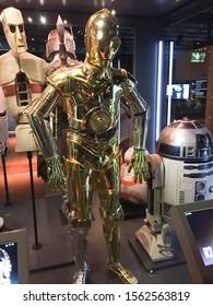 Bruxelles / Belgium - 08 21 2018 : Star Wars robot C-3PO costume starwars identities exhibition