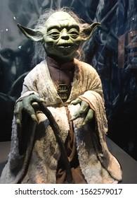 Bruxelles / Belgium - 08 21 2018 : Star Wars Identities Exhibition yoda with authentic costume StarWars