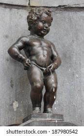 BRUXELLES, BELGIUM - APRIL 6, 2014: Manneken pis ( Little Man Pee or le Petit Julien) is an iconic town symbol