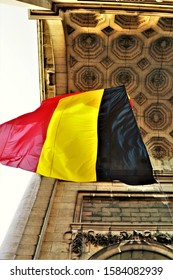 Bruxelles, Belgium. November 2019. Close up of the Belgian flag, hung inside the arch of the park of the fiftieth anniversary. Park in memory of Belgian independence.