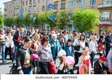 BRYANSK, RUSSIA - MAY 9, 2015: Procession of people with their relatives in Immortal Regiment on annual Victory Day, May, 9, 2015 in Bryansk city, Russia.