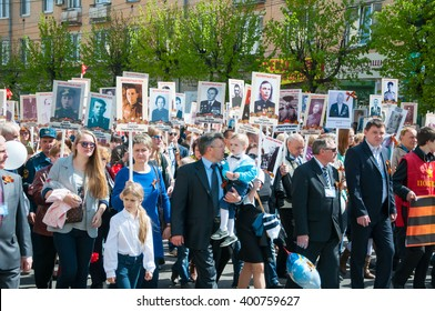 BRYANSK, RUSSIA - MAY 9, 2015: People on march with photos relatives in Immortal Regiment on the annual Victory Day, May, 9, 2015 in Bryansk city, Russia.