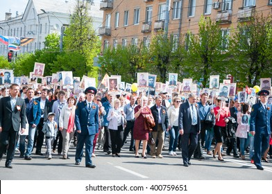 BRYANSK, RUSSIA - MAY 9, 2015: Procession of people with photos of their relatives in Immortal Regiment march the on annual Victory Day, May, 9, 2015 in Bryansk city, Russia.