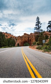 BRYCE CANYON NATIONAL PARK - 22 AUG 2018: Road driving through tunnel arch at Red Rock State Park near Bryce Canyon National Park