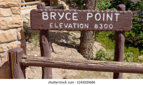 Bryce Canyon National Park, is known for crimson-colored hoodoos, .  It has overlooks at Sunrise , Sunset , Inspiration  and Bryce Point. this image is for Bryce Point sign
