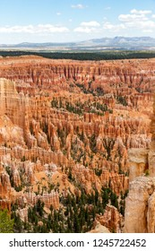 Bryce Canyon National Park, is known for crimson-colored hoodoos, which are spire-shaped rock formations. this image is for Bryce Point