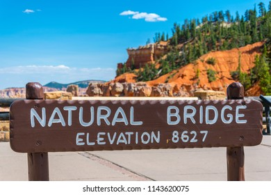 BRYCE CANYON NATIONAL PARK, UTAH, USA - JUNE 26, 2018: Natural Bridge sign and overlook in the beautiful Bryce Canyon National Park in Utah, USA