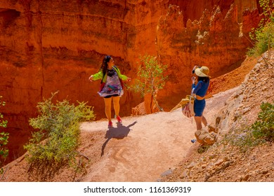 BRYCE CANYON, UTAH, JUNE, 07, 2018: Hikers in Bryce Canyon hiking in beautiful nature landscape with hoodoos, pinnacles and spires rock formations. Bryce Canyon National Park, Utah, USA in summer