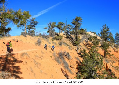 Bryce Canyon, UT-USA, November 14, 2018 : Four hikers walking on the rim trail at Bryce Canyon National Park, Utah State.