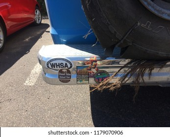Bryce Canyon, UT/USA - September 10, 2018: Closeup of travel related bumper stickers on a blue van with a shredded spare tire and steel belts hanging out