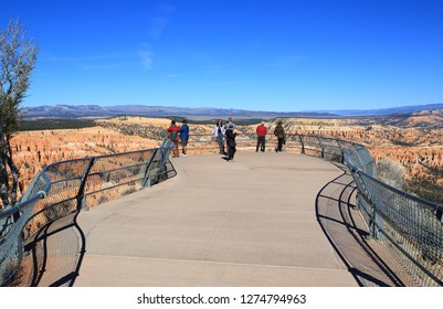 Bryce Point, Utah, USA - November 14, 2018: Tourists enjoys amazing view of Bryce Canyon from Bryce Point Overlook.