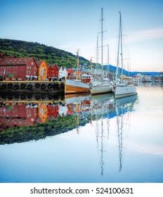 Bryggen street with boats in Bergen, UNESCO World Heritage Site, Norway