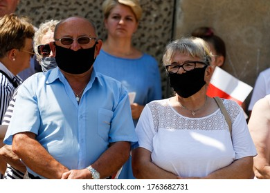Brzeg, Poland - June 13, 2020: Masked citizens coming to meet with the President of Poland at Zamkowa Square