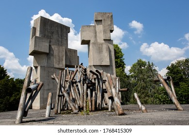 Brzeg, Poland - June 13, 2020: Monument to Polish and Soviet soldiers in the Wroclawska street. Two obelisks built of cuboids rise on a large concrete slab.