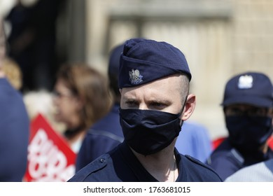 Brzeg, Poland - June 13, 2020:Polish policeman with a mask on his face keeps order during a meeting between the President of Poland and the townspeople