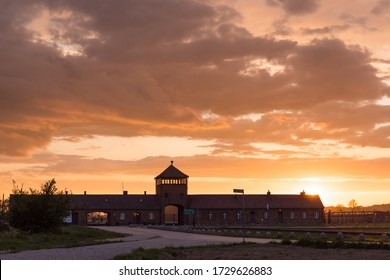 Brzezinka, Poland - May 1, 2020: Main entrance to the nazi concentration and extermination camp Birkenau at sunset.