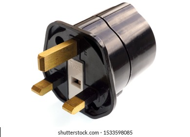 A BS 1363 travel adaptor for british sockets with white background