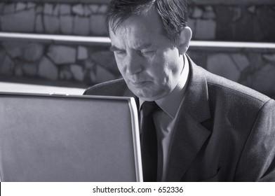 bsinessman working on the laptop