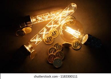 BTC among avid bulbs. The light flashes, an electrical short circuit. Closeup, Shallow depth of fields.